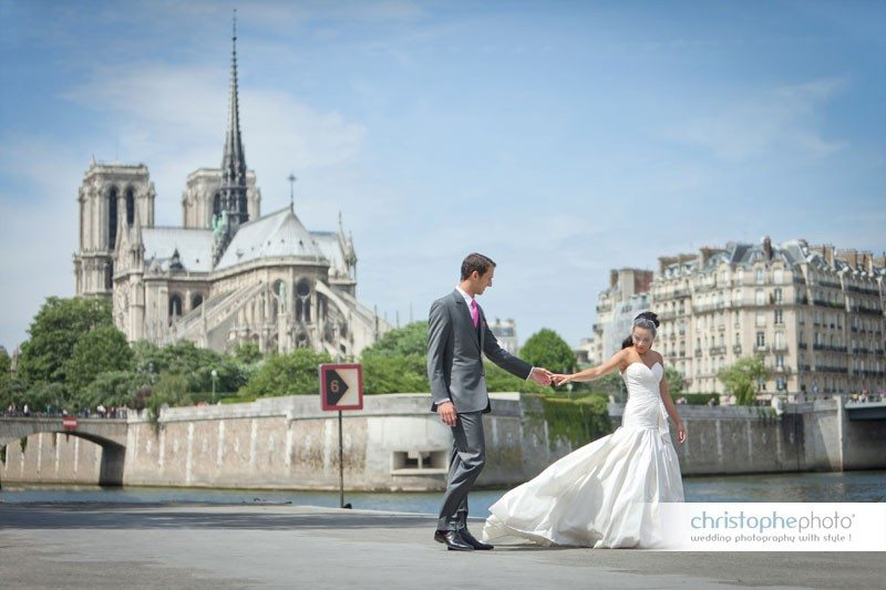 Bride and groom portrait behind Notre Dame Cathedral in Paris.