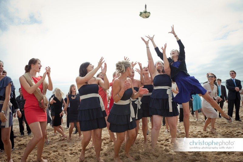 Throwing the bouquet in the air. The girls are jumping like crazy to catch it.