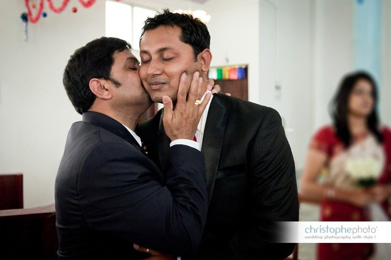 Family love after the catholic service. A very intimate moment. wedding photographer india Andaman