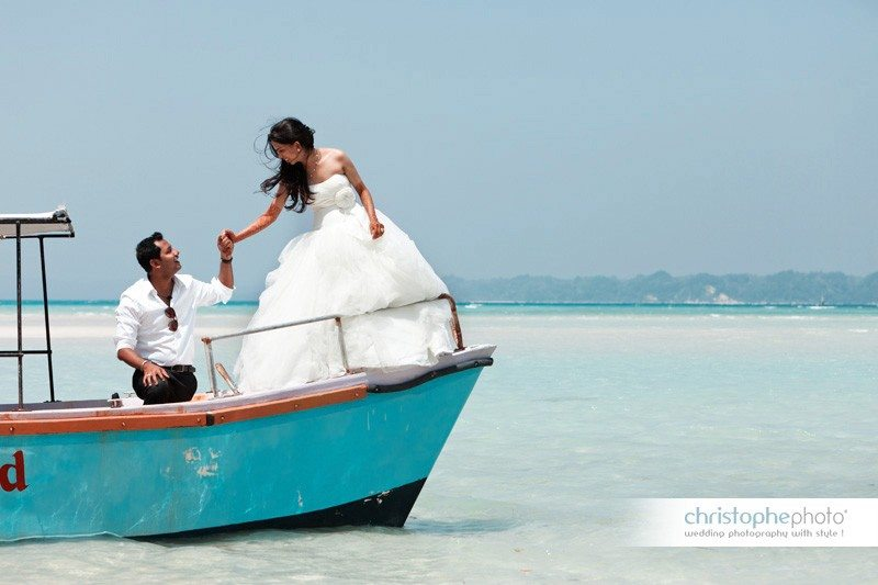 Portrait session at the beach. Pristine water and sand patch as a backdrop by wedding photographer india.