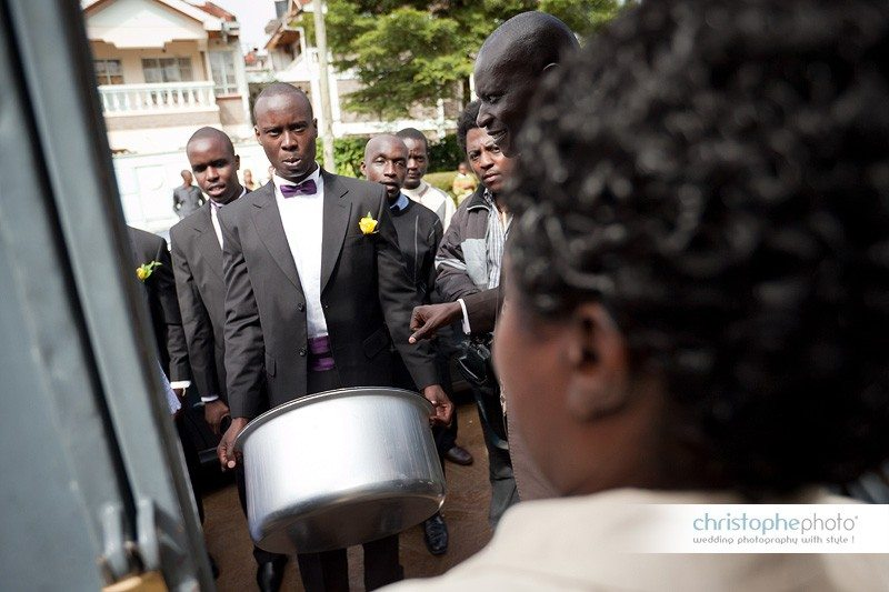Collecting the bride by the boys and offering a cooking pot.