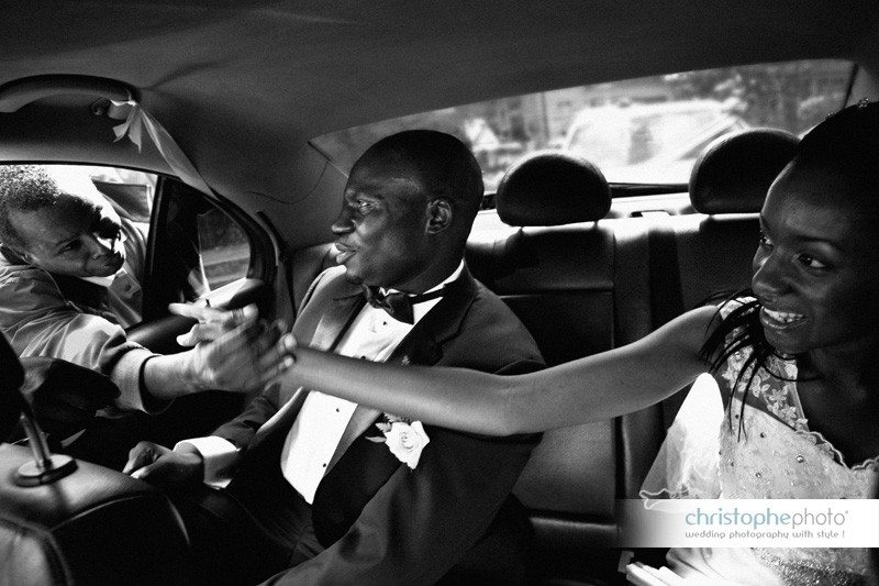 Family member greeting throught the car window at the of the ceremony by Wedding Photographer Nairobi Kenya Congo