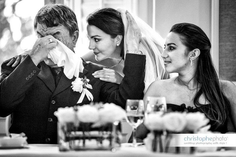The bride is standing next to her sister and her father who is becoming emotional. Wedding Photographer Croatia.