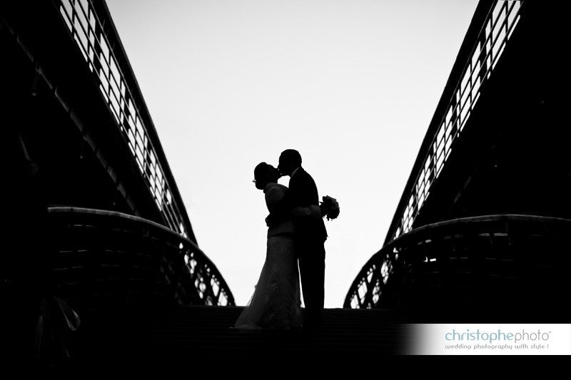 Silhouette in Paris on the Senghor Bridge over the Seine River by Wedding Photographer Paris