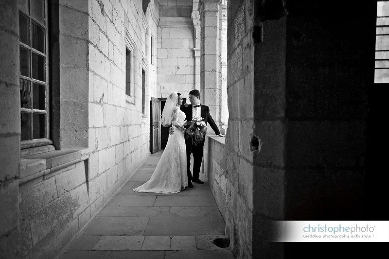 Black and white picture of the russian bride and groom exploring the little corners of the Chateau.