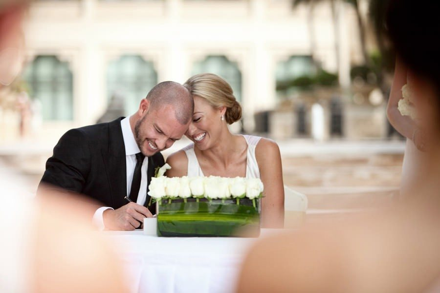 Bride and groom signing the wedding certificate in Dubai