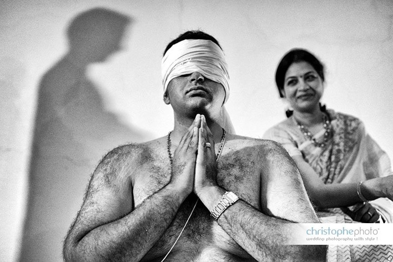 groom during a prewedding brahmin ceremony where he gets his second string to symbolize his new marital status