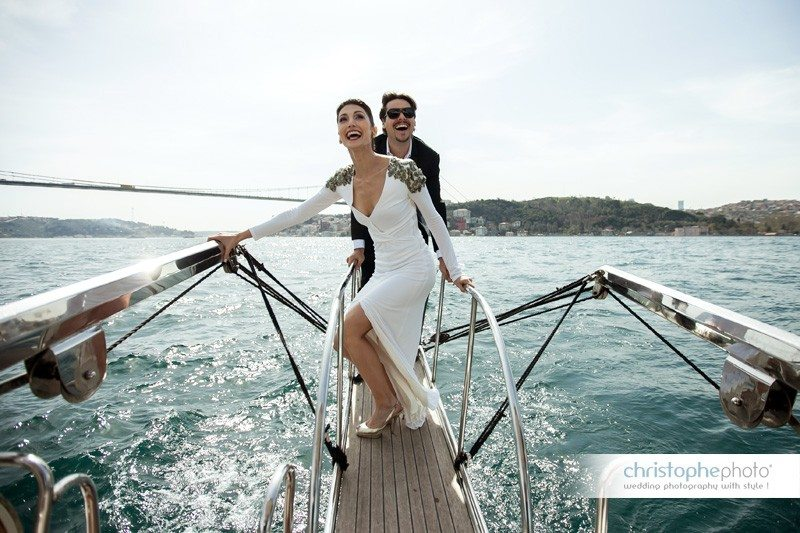 Wedding Photo Istanbul. Couple having fun on the boat cruising towards the Black Sea.